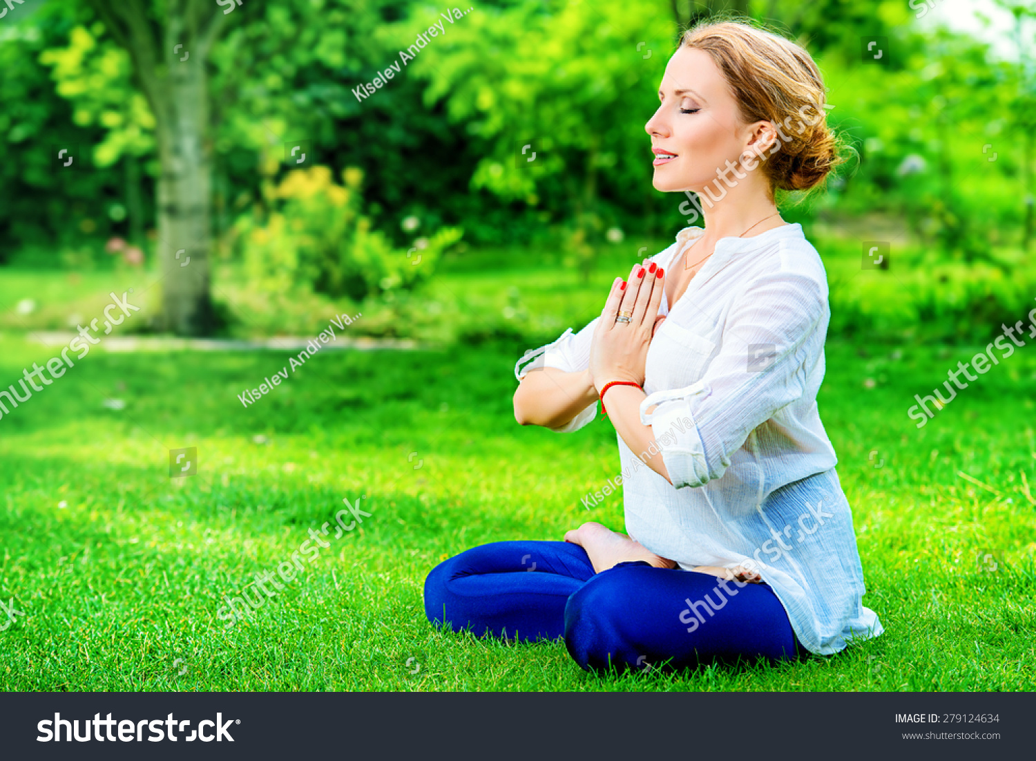 Stock Photo Beautiful Young Woman Doing Yoga In The Summer Park Healthy Lifestyle Yoga Lotus Pose 279124634 B F Ascher Company Inc